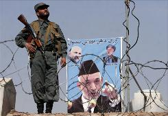 President Hamid Karzai, shown at bottom of poster, promised to root out corruption.