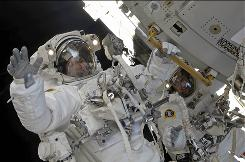 Spacewalkers Mike Foreman, left, and Randy Bresnik, right, undertook the second spacewalk of Atlantis' visit to the International Space Station.