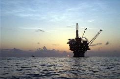 Oil platforms like this one in the Gulf of Mexico are being targeted in courts by some as generating greenhouse gases and contributing to global warming.