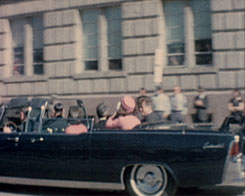 President John F. Kennedy and his wife, Jacqueline, ride in a motorcade moments before the president was fatally shot on November 22, 1963.