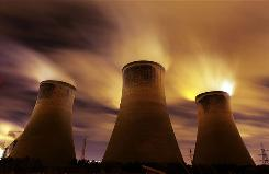 The coal fueled Fiddlers Ferry power station emits vapor into the night sky in Warrington, United Kingdom. As world leaders prepare to gather for the Copenhagen Climate Summit in December, the resolve of the industrial nations seems to be weakening with President Obama stating that it would be impossible to reach a binding deal at the summit.
