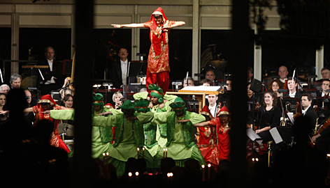 Indian-themed dancers perform during the entertainment segment of a state dinner hosted by resident Obama for India's Prime Minister Manmohan Singh, in this picture taken through the transparent walls of a giant tent on the South Lawn of the White House on Tuesday.