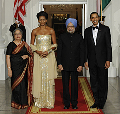 President Obama and first lady Michelle Obama welcome India's Prime Minister Manmohan Singh and his wife Gursharan Kaur to the state dinner at the North Portico of the White House on Tuesday.