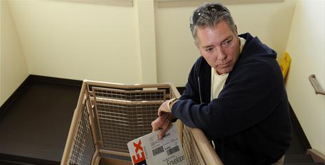 Marshall Callahan holds an envelope that contained a letter informing him that his attorney had secured a continuance after Callahan missed his court date.