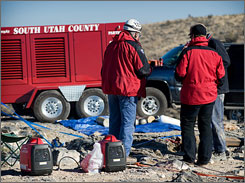 Rescue workers gather at Nutty Putty Cave in Utah.