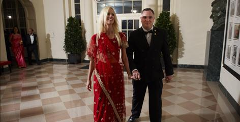 Tareq Salahi and Michaele Salahi arrive for the state dinner at the White House on Tuesday. The Secret Service is checking into its own security procedures after the Virginia couple managed to slip in.