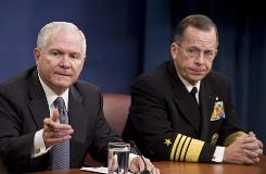 "Defense Secretary Robert Gates, left, accompanied by Joint Chiefs Chairman Adm. Michael Mullen, gestures during a news conference at the Pentagon on Nov. 19 to discuss the Fort Hood shootings.  Gates has ordered a panel to review the incident to examine ""internal weaknesses"" that may have left the military vulnerable to the attack."