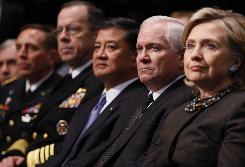 Secretary of State Hillary Rodham Clinton and Defense Secretary Robert Gates sit with military leaders during Obama's speech at West Point.
