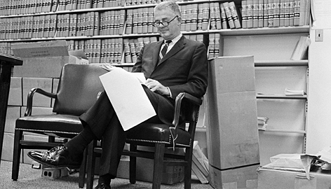 "Special Watergate prosecutor Archibald Cox sits in his Washington office on Aug. 29, 1973, as he reads U.S. District Judge John Sirica's order that President Nixon produce tapes of the White House conversations on Watergate for private judicial inspection. In an incident known as the ""Saturday night massacre,"" Cox was fired on President Nixon's orders on a Saturday night in 1973, hours after Cox held a news conference to defy him."