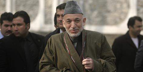 Afghan President Hamid Karzai spent an hour on the phone with President Obama Tuesday discussing troop levels, security, political and economic elements of his revised war plan.