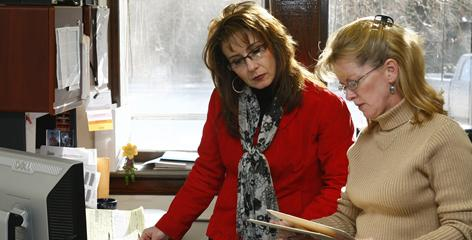 Michelle Zimmerman, left, takes on about seven different official roles in Sioux County, Neb.