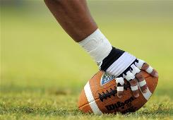 A lineman prepares to snap the football during training camp in Orlando, Fla. In a study, 19 of 29 Ohio State University linemen were obese.