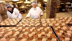 Marta Gusman, center, prepares turkey wraps at Revolution Foods in Oakland The small start-up is pushing to make mostly organic, natural, fresh entrees that are priced just above the federal reimbursement that most schools get from the USDA.