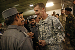 Gen. Stanley McChrystal, right, speaks to Afghan military officers after a briefing Wednesday.