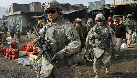 U.S. troops patrol Wednesday in Kabul. President Obama's plan will send 30,000 U.S. reinforcements.