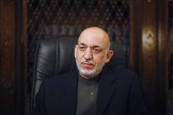 "President Hamid Karzai accused ""Western political circles"" of trying to deny him re-election."