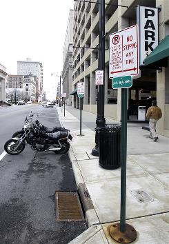 Columbus, Ohio has sold 147 parking permits for two-wheeled vehicles so far, according to a spokesman for the mayor.