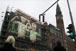 "The ""Hopenhagen Earth Body Guard"" billboard in the center of Copenhagen urges people to sign a climate change petition."