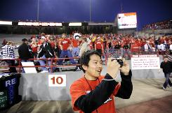 University of Nebraska student Bojiao Sun takes pictures of the field before at Memorial Stadium in Lincoln before the Cornhuskers' showdown with Oklahoma Nov. 7.