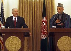 Secretary of Defence Robert Gates, left, and Afghan President Hamid Karzai attend a news conference on Tuesday in Kabul.
