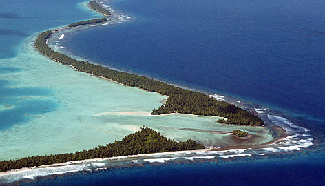 The South Pacific pounds the coastline of Funafuti Atoll of Tuvalu - Courtesy of USAToday.com