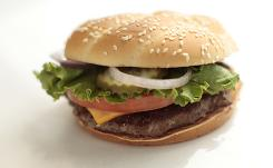 McDonald's, Burger King and Costco test ground beef they buy five to 10 times more often than the USDA tests beef made for schools during a typical production day. McDonald's Angus Third Pounder burger featured above. 