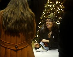 Former Alaska governor Sarah Palin's book tour has seen thousands of fans camped out overnight, sometimes in bitter cold temperatures, for a chance to shake her hand.