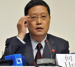 Chinese Vice-Minister for Foreign Affairs He Yafei answers questions in the press area of the Bella center in Copenhagen on Friday. He sharply criticized a U.S. delegate.