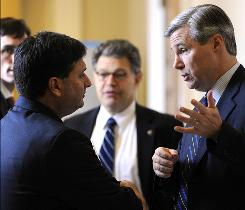 Sen. Sheldon Whitehouse, D-R.I., right talks with Ron Klain, chief of staff for Vice President Biden on Dec. 8. Also pictured is Sen. Al Franken, D-Minn.