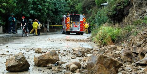 Rock debris blocks the roadway on La Presa Drive in the Hollywood Hills section of Los Angeles on Saturday.