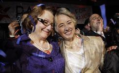 Mayor-elect Annise Parker, right, celebrates her runoff election victory with partner Kathy Hubbard on Saturday in Houston.