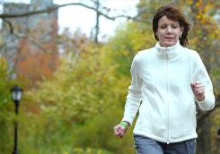 Liesbeth Stoeffler, 50, a former marathon runner, jogs in New York's Central Park three months after having a lung transplant. Stoeffler was on an ECMO machine, which oxygenates the blood directly, instead of a ventilator for 20 days while she waited for the transplant.