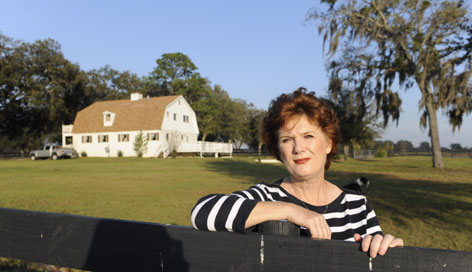 Colleen Wells has been trying to sell the Ocala, Fla. horse farm she and her husband fixed up and hoped to resell. He has since died and she is also trying to sell the home she currently lives in because both mortgages are cutting into her savings.