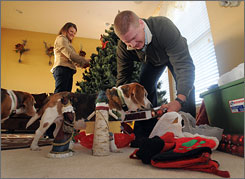 Heidi and Brad Kroft set up Christmas decorations in their Fishers, Ind. home. The two moved into the bigger home after being surprised at how quickly their former Indianapolis home sold.
