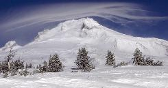 A cloud formed Sunday over Mount Hood where two of three climbers were still missing. Severe weather was hampering search efforts after the body of one climber was recovered.