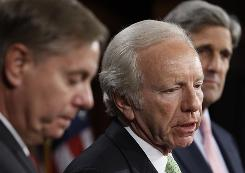 From left, Sens. Lindsey Graham, R-S.C.; Joe Lieberman, I-Conn.; and John Kerry, D-Mass., discuss comprehensive climate change and energy independence legislation.