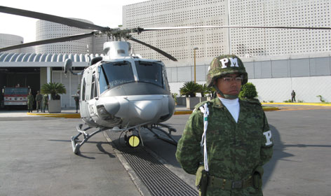 One of the Bell 412 helicopters given to the Mexican air force by the United States is on display Tuesday in Mexico City - part of an aid package intended to combat drug cartels with thousands of foot soldiers.