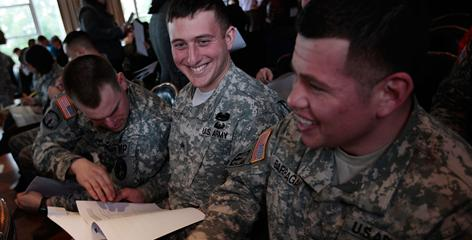 Army soldiers joke while they fill out a questionnaire about mental fitness Tuesday at Fort Hamilton in Brooklyn, N.Y.