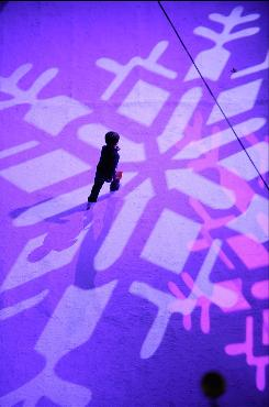 A child crosses the ice at the rink at Rockefeller Center during the Christmas tree lighting ceremony on Dec. 2 in New York City.