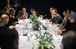 President Obama, left, speaks during a multi-lateral meeting with Indian Prime Minister Manmohan Singh, right, Chinese Prime Minister Wen Jiabao, second from right, and other leaders at the Bella Center in Copenhagen on Dec. 18 at the COP15 UN Climate Change Conference.