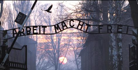 """The sign stolen from the main gate of the Nazi-era concentration camp at Auschwitz has a German phrase that means """"Work sets you free."""""""