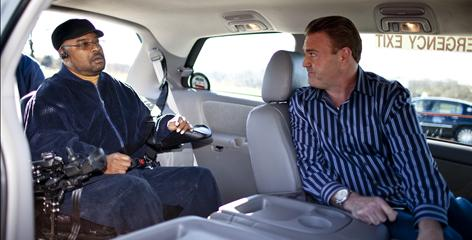 Bobby Coward, left, enters a wheelchair-accessible taxi as he speaks with Jeffrey Schaeffer, president of District Cab, ahead of a sensitivity training session for the company's phone operators.
