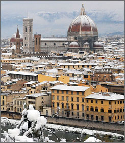 "The ""Duomo"" Basilica di Santa Maria del Fiore cathedral towers over a snow-covered Florence, Italy, Saturday."