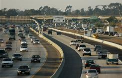 Vehicles cruise north bound down the center commuter high occupancy toll lane of Interstate 15 near CA-163 north east of downtown San Diego. The lanes are easing gridlock in Miami, Minneapolis, Seattle and other cities.