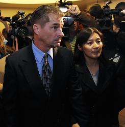 Richard Heene and his wife, Mayumi Heene, right,  are flanked by members of the media after they both plead guilty to charges related to the alleged hoax of the couple claiming that their son, Falcon Heene was last month onboard a helium balloon, at the Larimer County Courthouse on November 13 in Fort Collins, Colorado.