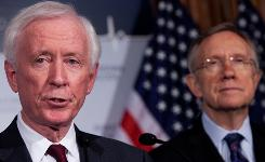 American Medical Association President-elect Cecil Wilson, and Senate Majority Leader Harry Reid, D-Nev., speak at a news conference on health care legislation on Monday.