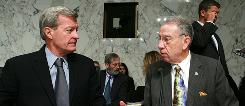 Senate Finance Chairman Sen. Max Baucus, D-Mont., left, talks with the committee's ranking Republican Sen. Chuck Grassley, R-Iowa. Records from both senators' campaigns show that their top campaign donors included health care interests.