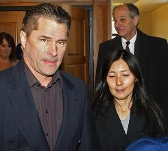 "Richard and Mayumi Heene leave court after sentencing on Wednesday in Fort Collins, Colo., in connection with the ""Balloon Boy"" hoax."