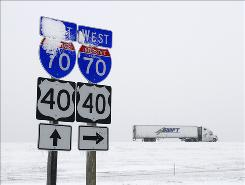 A stretch of Interstate 70 in Kansas was snowpacked by mid-afternoont. The state Department of Transportation warned that travel would be almost impossible in northeast Kansas by Thursday afternoon.