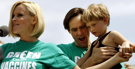 Actress Jenny McCarthy calls for the elimination of toxins from children's vaccines as actor Jim Carrey holds her son, Evan Asher, at a 2008 rally in Washington.